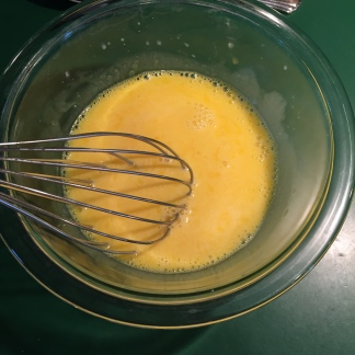 whisking egg yolks