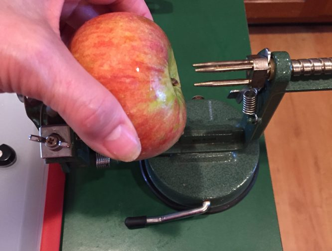 line up the apple stem to prongs, stern to corer